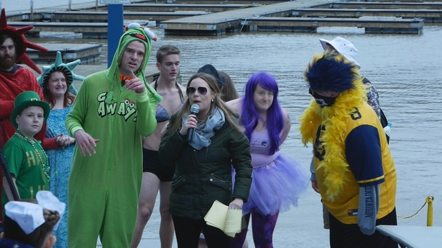 Dozens of Jumpers Dive into Cold Water during Fargo Polar Plunge